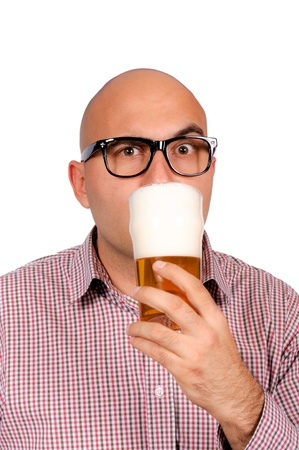 Bald man drinking the glass of beer photo