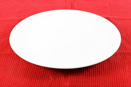 White empty plate on red  photo