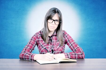 Serious teacher siting on the desk Stock Photo - 16129219