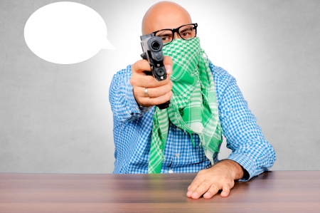 Bald guy with the gun. Selective focus on the man Stock Photo - 16129212