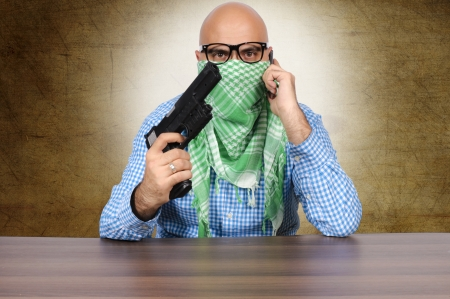 Terrorist negotiator with gun and cell phone Stock Photo - 16129210