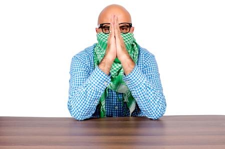 Bald terrosit doing the pray isolated on white Stock Photo - 16129203
