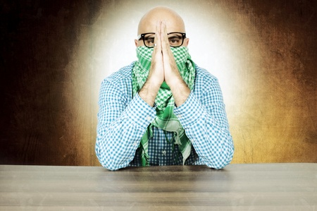 Bald terrosit doing the pray Stock Photo - 16129209