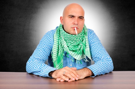 Man with the cigarette. Selective focus on cigarette. Stock Photo - 16129217