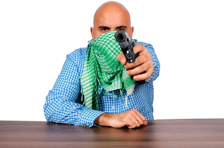 Bald man with the gun. Selective focus on the man. Stock Photo - 16129204