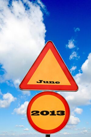 June 2013 on the road sign with cloudscape photo