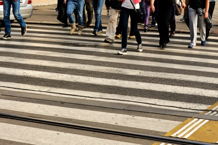 People crossing the pedestrian crossing photo