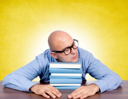 achiever: Bald guy sleeping on books