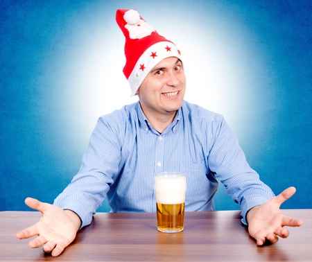Santa is happy with the glass of beer photo