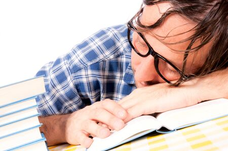 Man sleeping on the books Stock Photo - 16191399