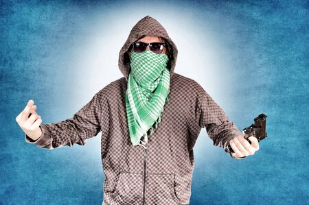 Rude gangster with scarf and hood photo