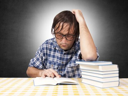 Man reading the book Stock Photo - 16239397