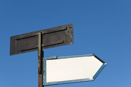 Blank signpost over blue sky photo