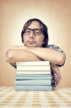Student laying down on the books Stock Photo - 16252882