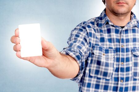 Man holding the blank white card photo