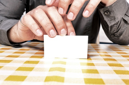 Blank white card in the hands Stock Photo - 16433424