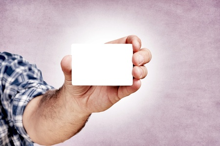 Man holding the blank white card on the purple background photo