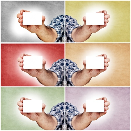 Hand and blank white cards in different colors photo
