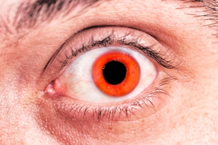 Selective focus on the scary red eye Stock Photo - 16663568