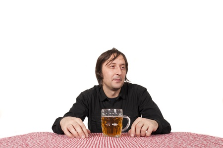 intoxicating: Man with pint of beer isolated on white