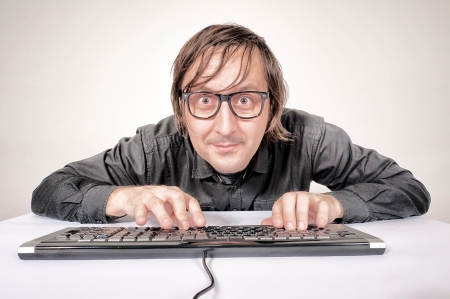 Hacker in Action on the keyboard