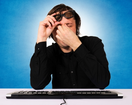 Tired programmer with headache Stock Photo - 16885122