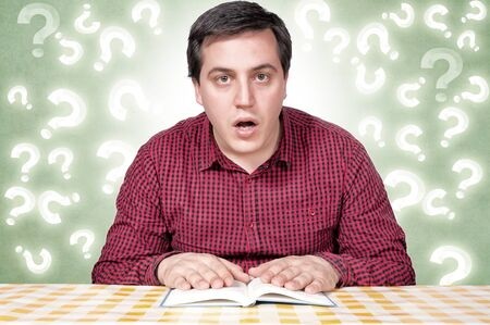 Confused man isolated on green background Stock Photo - 16958872