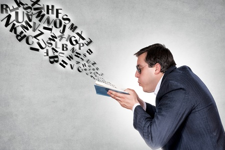 snuff: Man blowing letters from the book