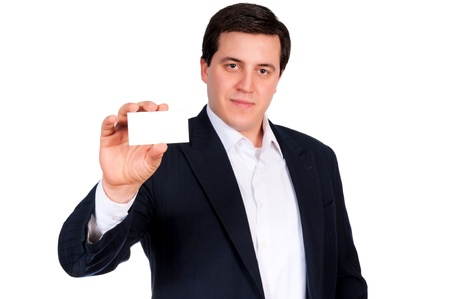 Serious businessman showing the blank calling card photo