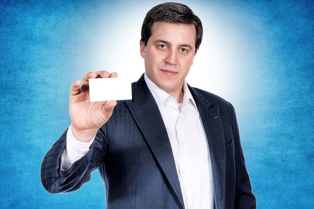earnest: Serious businessman showing the blank calling card