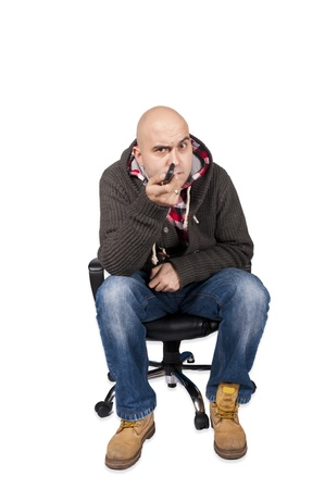 Man siting on the chair with remote Stock Photo - 16981954