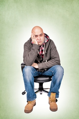 siting: Worried man siting on the chair Stock Photo