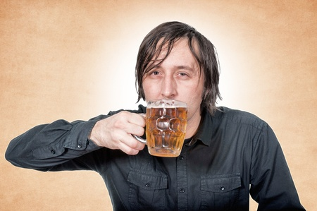 Man drinking the pint of beer photo