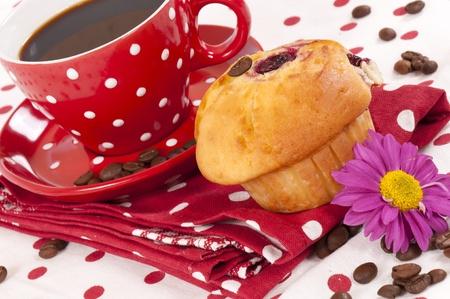 Fresh dark coffee and muffins photo