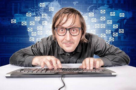 Hacker in Action sedning emails worldwide Stock Photo - 17038512