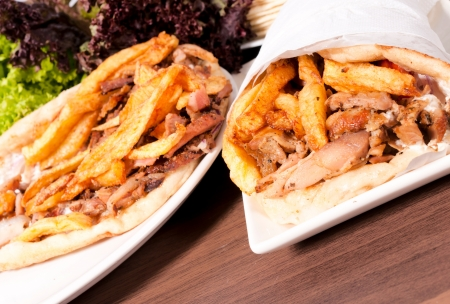 Portions of gyros on the table Stock Photo