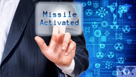 cyber defence: Man activating the missile pushing the button