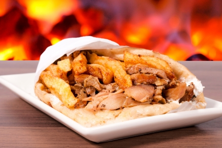 sandwiche: Portion of the gyros pita on the plate