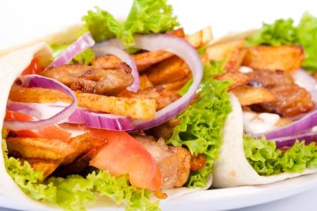 sandwiche: Messa a fuoco selettiva sul contenuto del panino tortilla sinistra