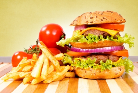 Double cheeseburger on the wooden table photo