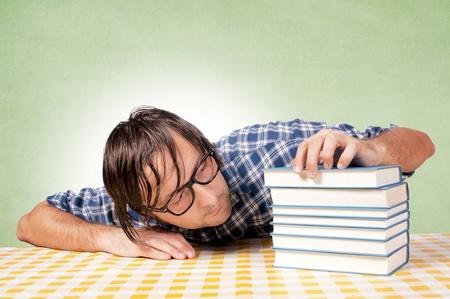 drowsiness: Man drowsiness on books
