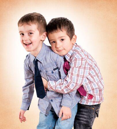 fraternal: Strong brother hug on orange background