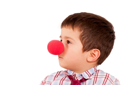 Boy with the clown nose isolated on white photo