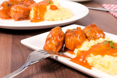 Selective focus on the meat balls and potato photo