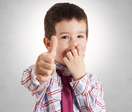 nose picking: Selective foccus on the kid hand with ok sign Stock Photo