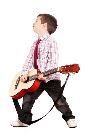 Little boy with guitar isolated on white photo