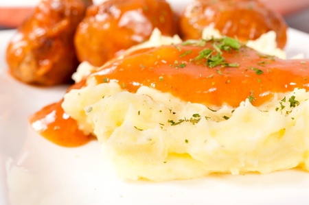 Mashed potato with meat balls photo