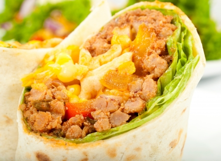 burrito: Selective focus on the meat and vegetables in tortilla Stock Photo