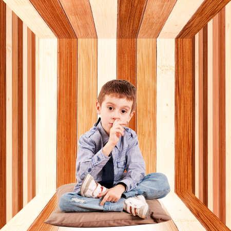 nose picking: Kid in box picking his nose Stock Photo