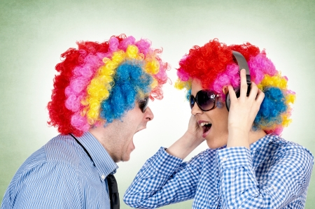 Married couple of clowns have conversation photo